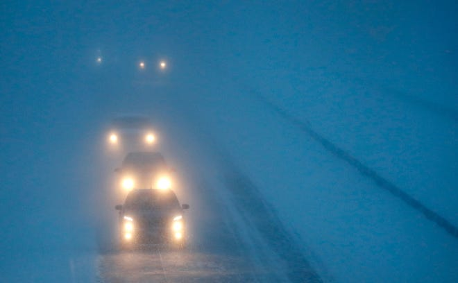 Headlights from morning commuters can be seen through blowing snow as they make their way along WI-441 during a snowstorm Monday, Jan. 28, 2019, in Appleton, Wis.Danny Damiani/USA TODAY NETWORK-Wisconsin