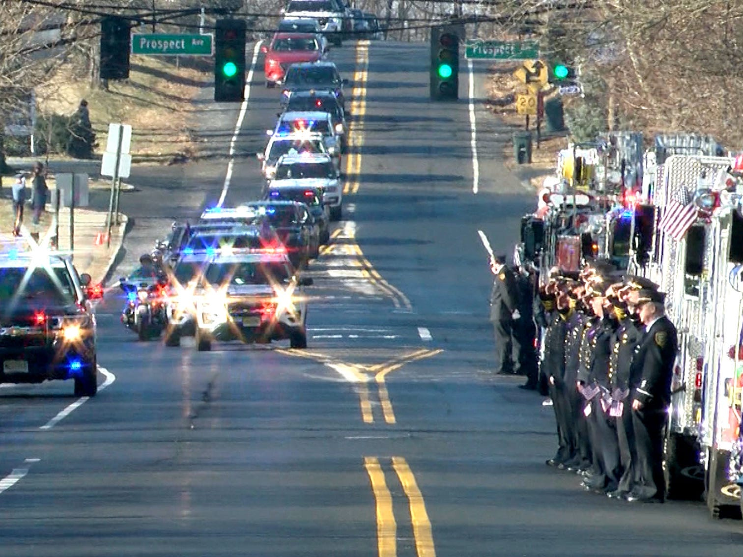 Firefighters salute as the funeral procession for Army Private First Class Jamie Riley drives along Harding Road in Fair Haven Monday morning, February 4, 2019.   Riley, who is from the town, died along with another soldier in a crash between two Stryker vehicles at McGregor Range in New Mexico.