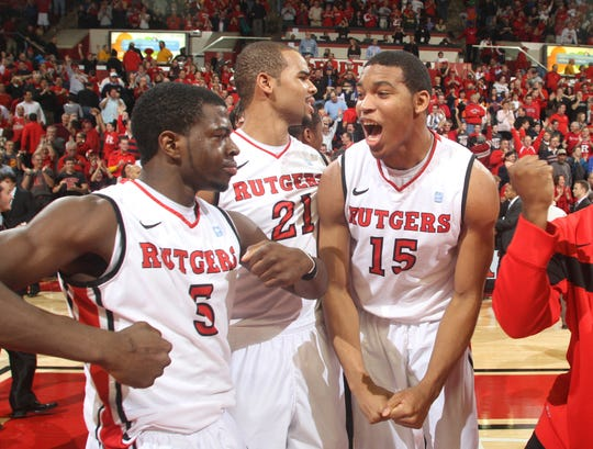 Rutgers players (L to R) Eli Carter, Austin Johnson, and Derrick Randall celebrate after the Knights upset Florida in double overtime, Thursday, December 29, 2011