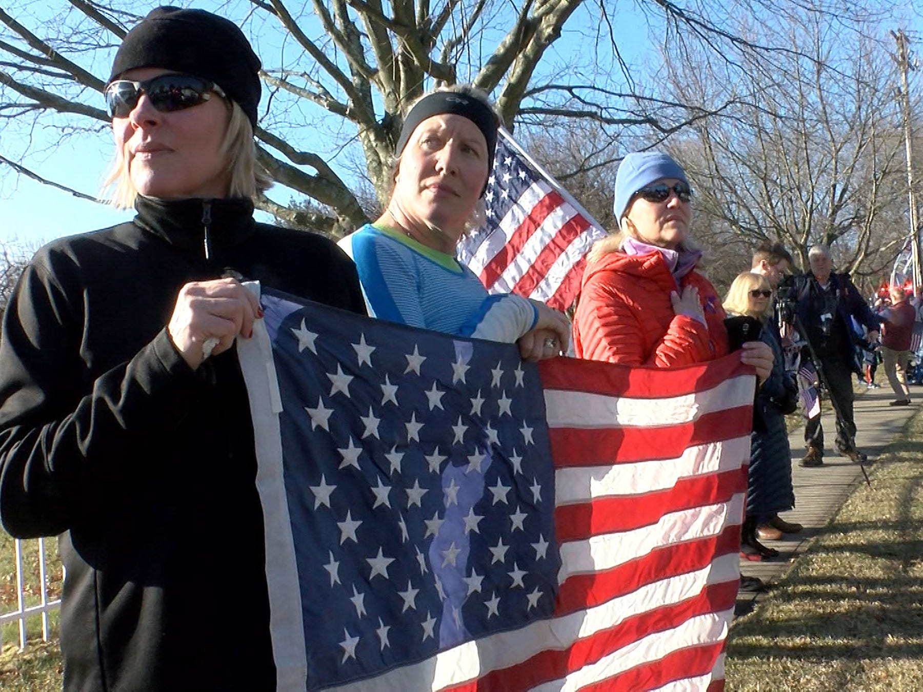 People show their respect for Army Private First Class Jamie Riley along Harding Road in Fair Haven Monday morning, February 4, 2019, including (L-R): Dara Pfeil, Lauren Adams and Lauren Gray, all from the town.   Riley, who is from the town, died along with another soldier in a crash between two Stryker vehicles at McGregor Range in New Mexico.