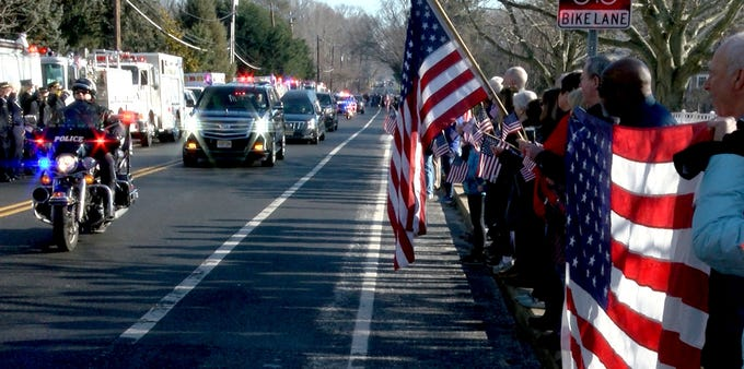 People show their respect as the funeral procession for Army Private First Class Jamie Riley drives along Harding Road in Fair Haven Monday morning, February 4, 2019.   Riley, who is from the town, died along with another soldier in a crash between two Stryker vehicles at McGregor Range in New Mexico.