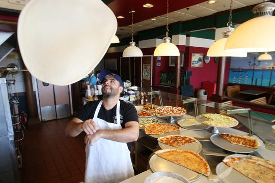 Tim Eldebeisi, owner of Cafe Villa, a West Long Branch-based business that serves pizza and other cuisine, makes a pizza at Cafe Villa in West Long Branch, NJ Monday, February 4, 2019.