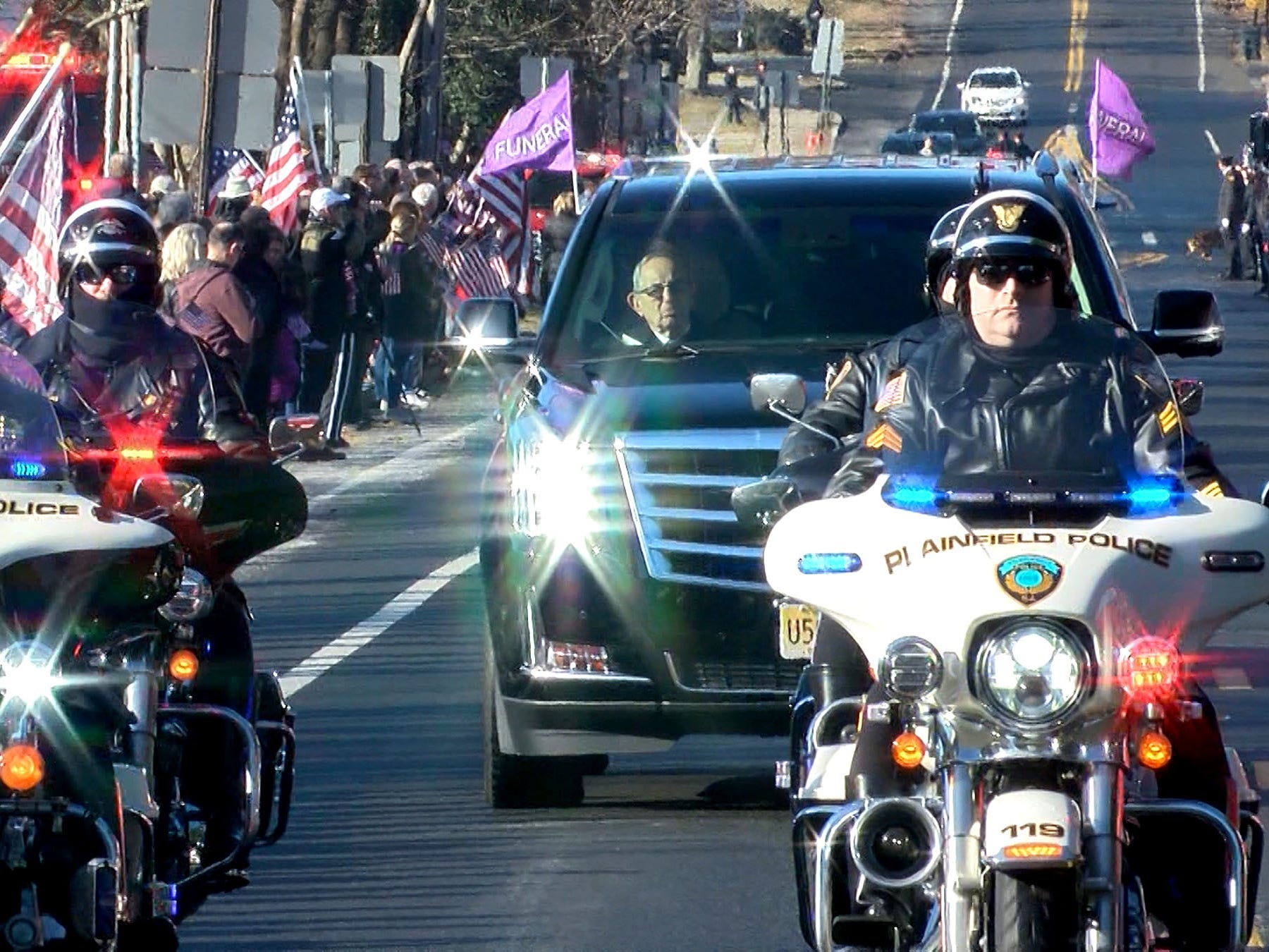 Plainfield Police motorcycles help lead the funeral procession for Army Private First Class Jamie Riley along Harding Road in Fair Haven Monday morning, February 4, 2019.   Riley, who is from the town and the son of Plainfield Police Director Carl Riley, died along with another soldier in a crash between two Stryker vehicles at McGregor Range in New Mexico.