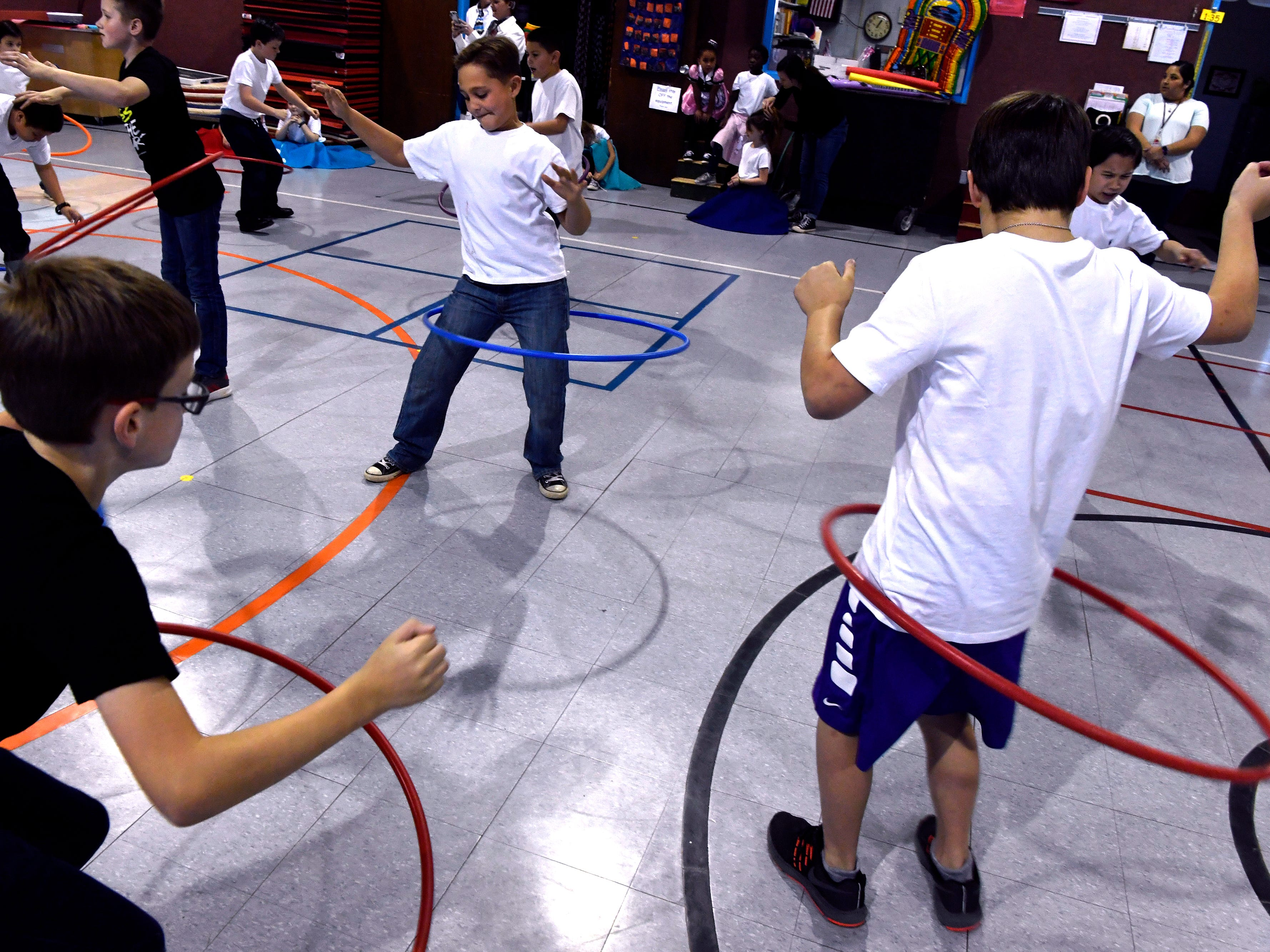 Third grade boys hula hoop in the Austin Elementary School gymnasium Jan. 25, 2019 as part of Fifties Day. Students from all grades also performed the Twist, the Stroll, and the Hand Jive for family and friends.