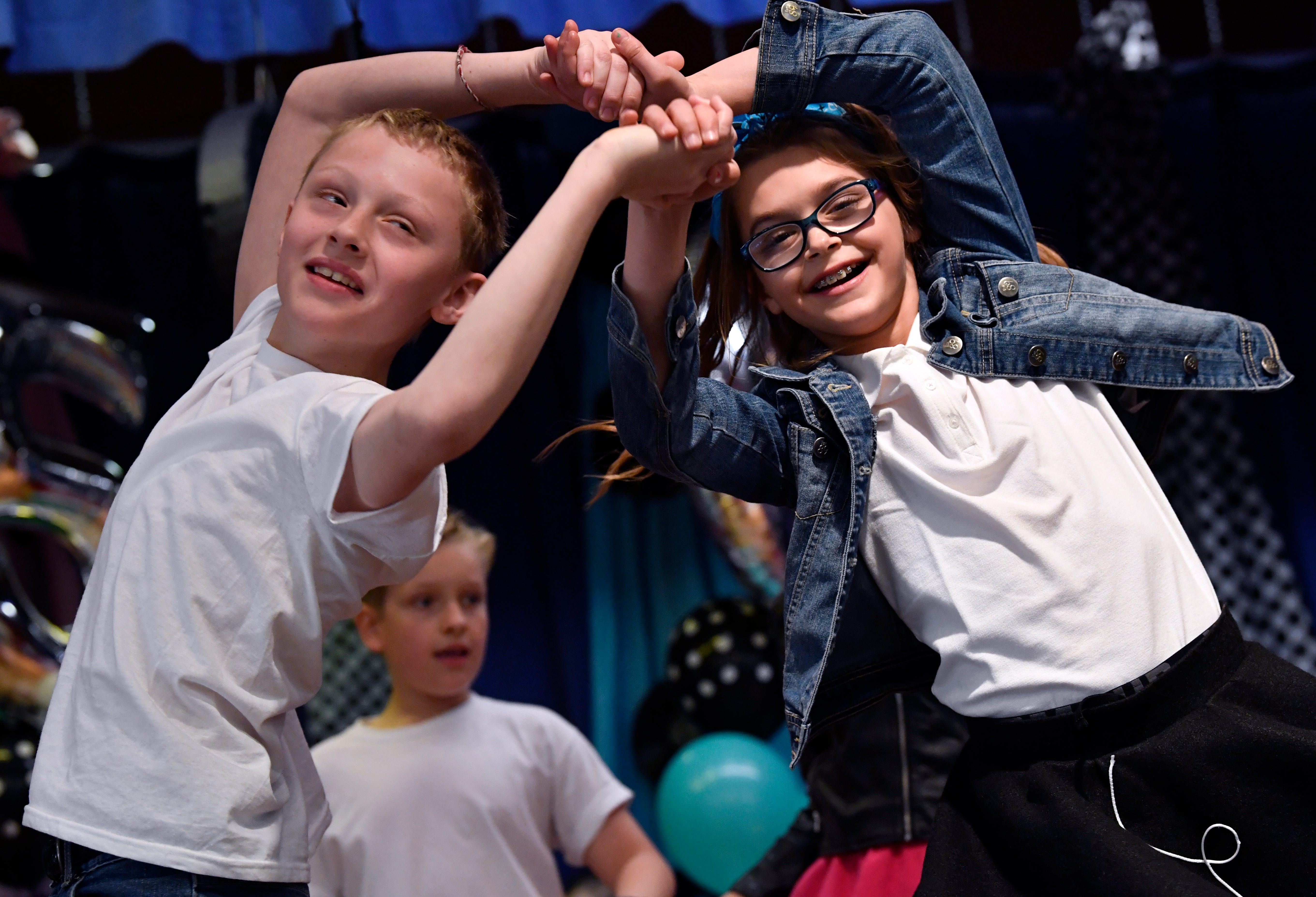 Fourth-graders Madden Cagle (left) and Payton Ellis, dance during Fifties Day at Austin Elementary School.