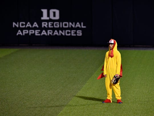 Dressed as a chicken, Cooper's Izaiah Clark waits in the outfield for a ball to come his way Saturday Feb. 2, 2019. Cooper and Abilene High played each other at Abilene Christian University in a costumed scrimmage benefiting the P4X Foundation.