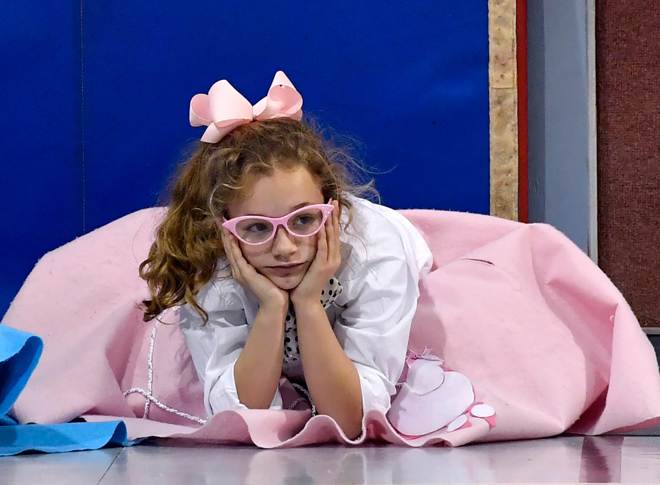Brinley McAdams waits for the next game to start during Fifties Day at the Austin Elementary School gymnasium.