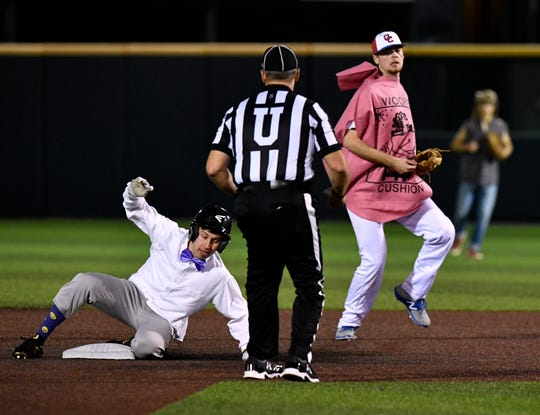 Abilene High's Lane Wilson slides into second base Saturday Feb. 2, 2019. Cooper and Abilene High played each other at Abilene Christian University in a costumed scrimmage benefiting the P4X Foundation.