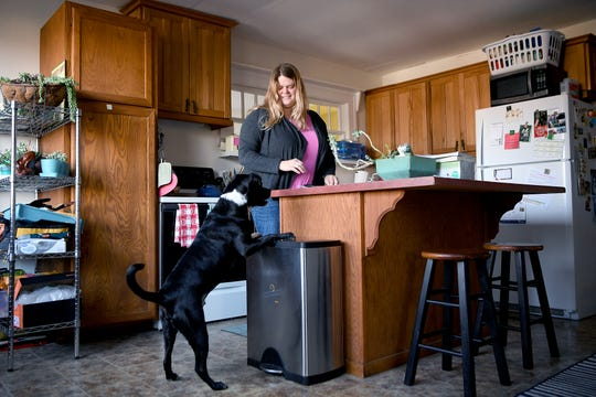 Sarah Moffitt, along with her dog, Jackson Connor, recently bought a home in the Oakley neighborhood of Asheville after moving from the Bay area of California. Moffitt chose her location to avoid highway traffic on her commute to her new job at Mission hospital.