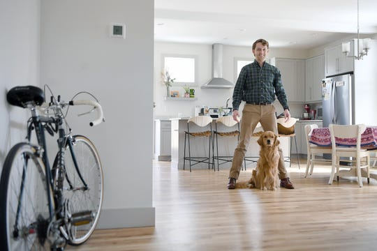 David Sanders, along with his wife, Kelsey, and dog, Daisy, recently purchased a home on the east side of Asheville. Coming from Raleigh the couple weren't shocked by the price points in the Asheville market for their first home.