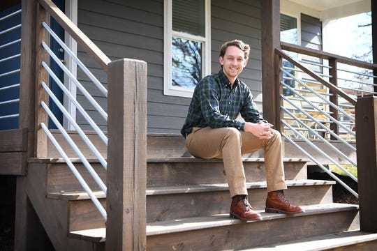 David Sanders, along with his wife, Kelsey, and dog, Daisy, recently purchased a home on the east side of Asheville. The couple chose new construction for their first home together to avoid hidden problems that can plague older houses.