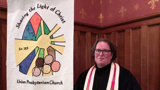 The Rev. Patricia Raube, pastor of Union Presbyterian Church, with its 200th anniversary motto.
