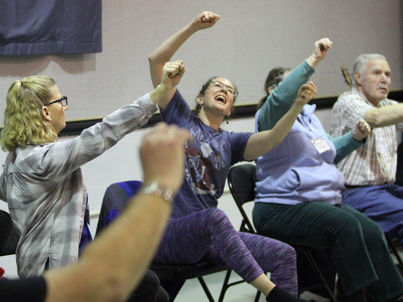 Dance for Parkinson's instructor Deborah Birrane, center of Seattle,  leads the class in a chair exercises.