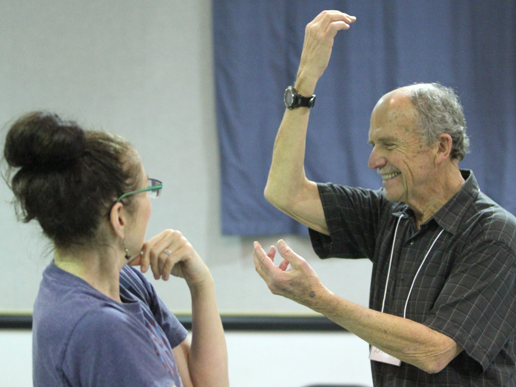 Dance instructor Deborah Birrane enjoys a laugh with Bill Meierding as she arranges him in a frozen position during the Dance for Parkinson's class.