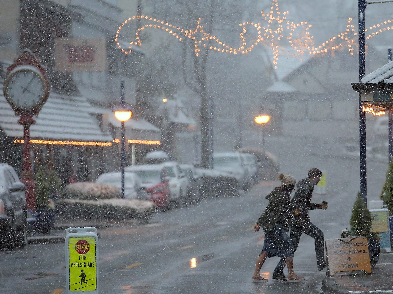 Pedestrians make their way through the heavy snow in downtown Poulsbo on Sunday, February 3, 2019.