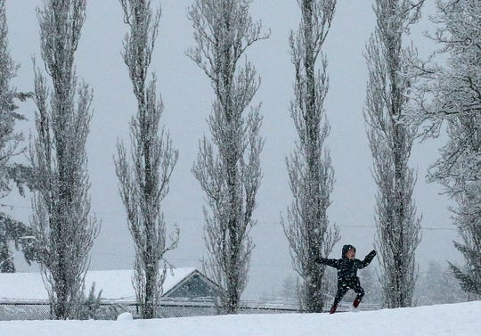 Marcus Stephan, 6, jumps for joy as he frolics in the snow at Raab Park in Poulsbo on Sunday, February 3, 2019.