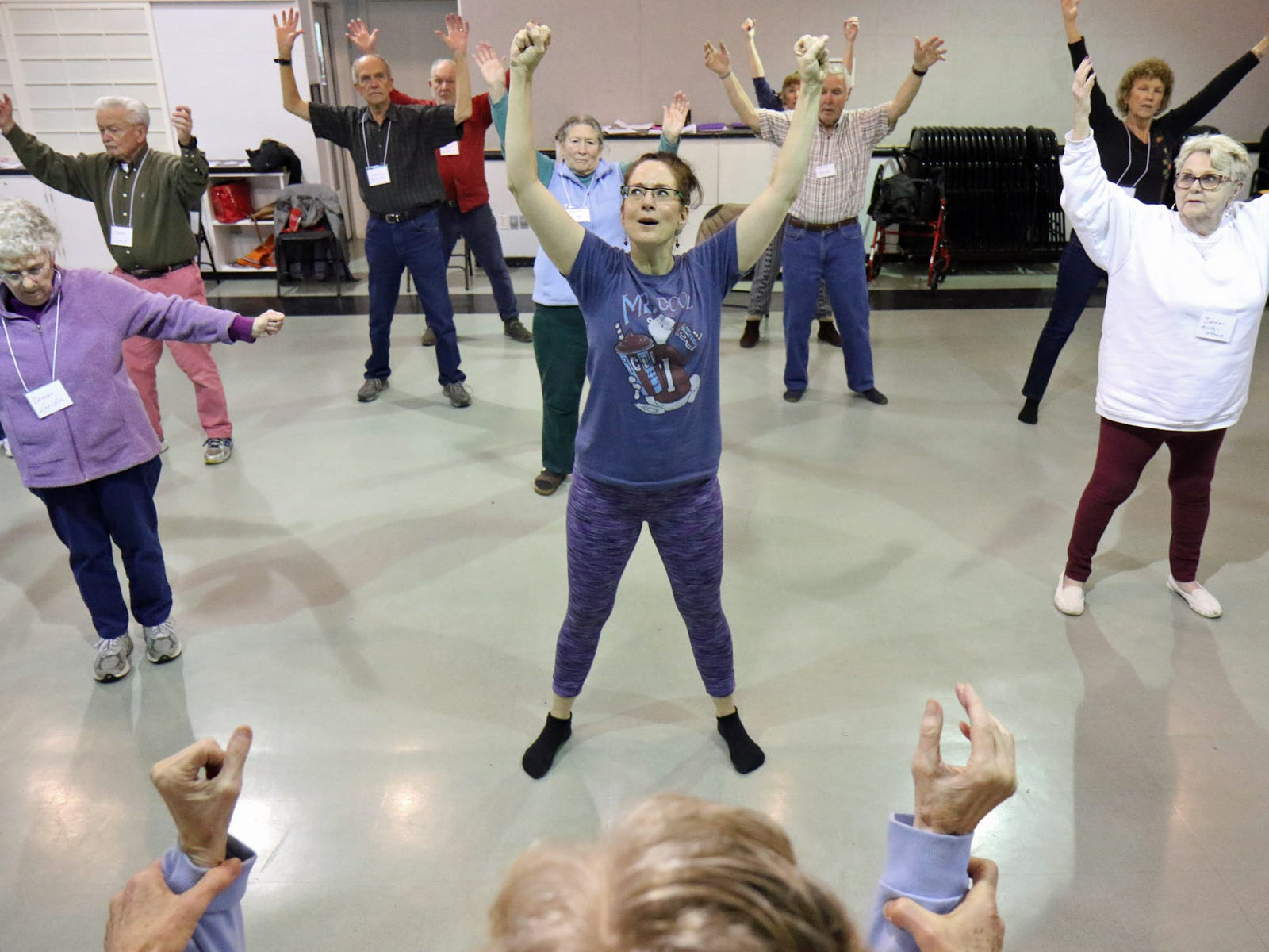 Dance for Parkinson's instructor Deborah Birrane, center, leads the class in floor exercises.