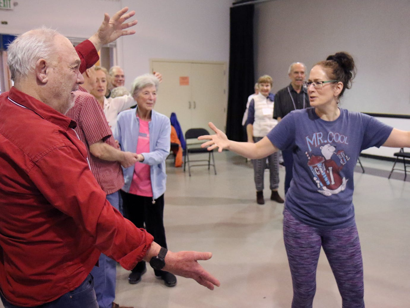 Dance for Parkinson's instructor Deborah Birrane, of Seattle,  works with Lee Jensen during one of the exercise routines of the class.