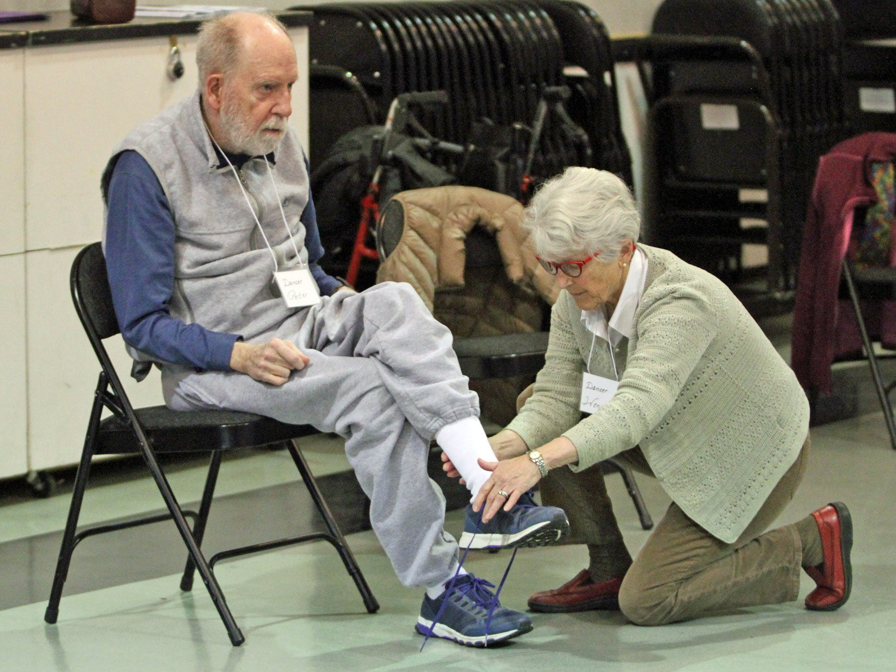 Wendy O'connor laces her husband Peter's shoes before floor exercises at the Dance for Parkinson's class held at the Bainbridge Island Senior Center.