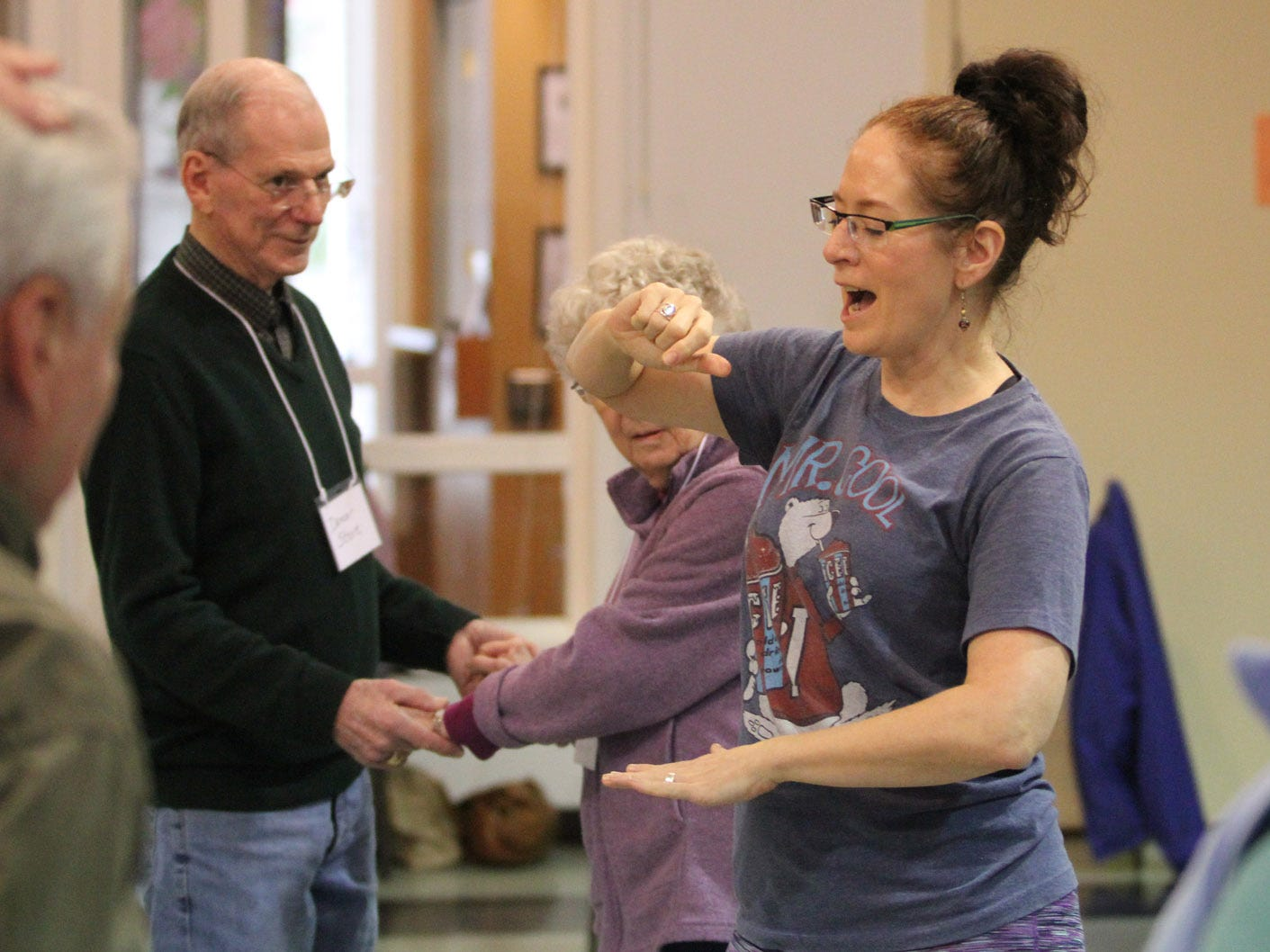 Dance for Parkinson's instructor Deborah Birrane, of Seattle,  leads her class in a floor exercise.