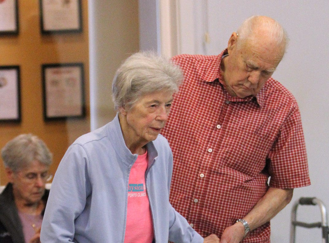 John Peters helps his wife Janet with exercises during the Dance for Parkinson's class held at the Bainbridge Island Senior Center.