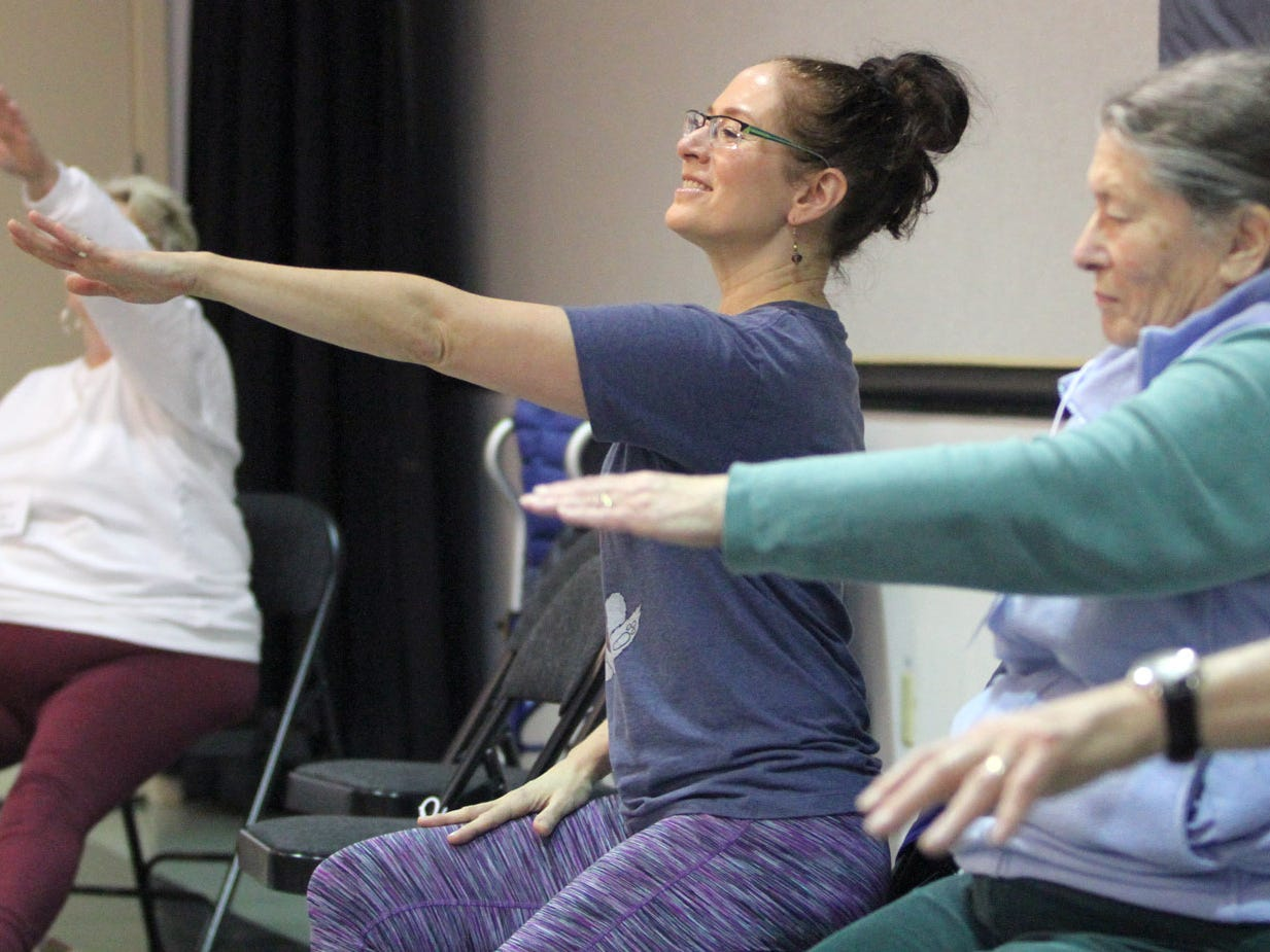 Dance for Parkinson's instructor Deborah Birrane, of Seattle,  leads the class during a set of chair exercises.