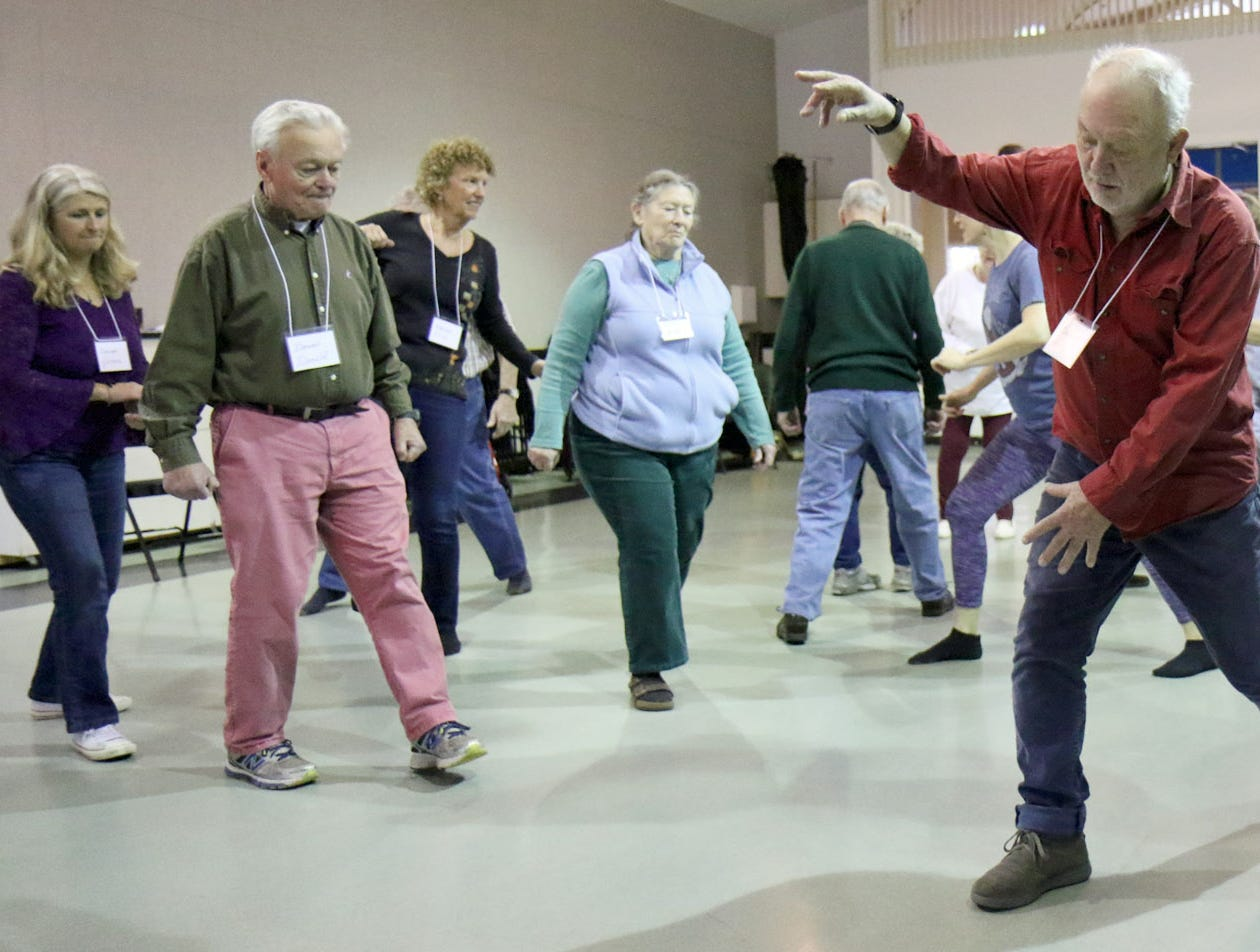 Lee Jensen, of Port Townsend, joins other members of the Dance for Parkinson's class in a free form walking exercise.