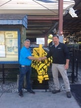 Brad Kenyon (left) is the owner of Boats & Motor Superstores, and Capt. John Donaldson  is the owner of Sea Tow Sebastian. The two recently announced a life jacket loaner program for area boaters