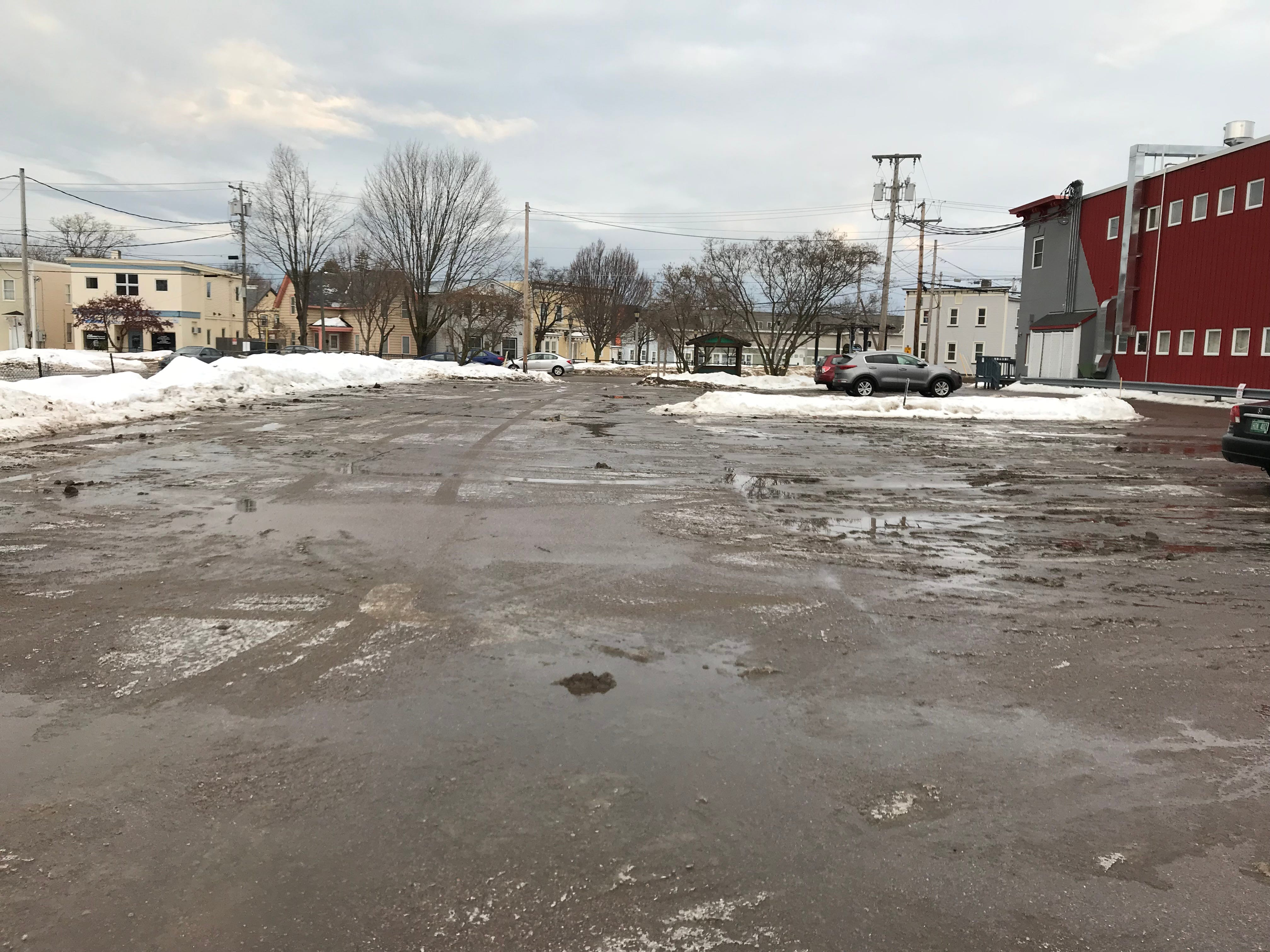 The parking lot of 294 N. Winooski Ave. in Burlington on Monday morning of Feb. 4, 2019. A University of Vermont student was found unconscious at this location on Saturday and was declared dead at the scene.