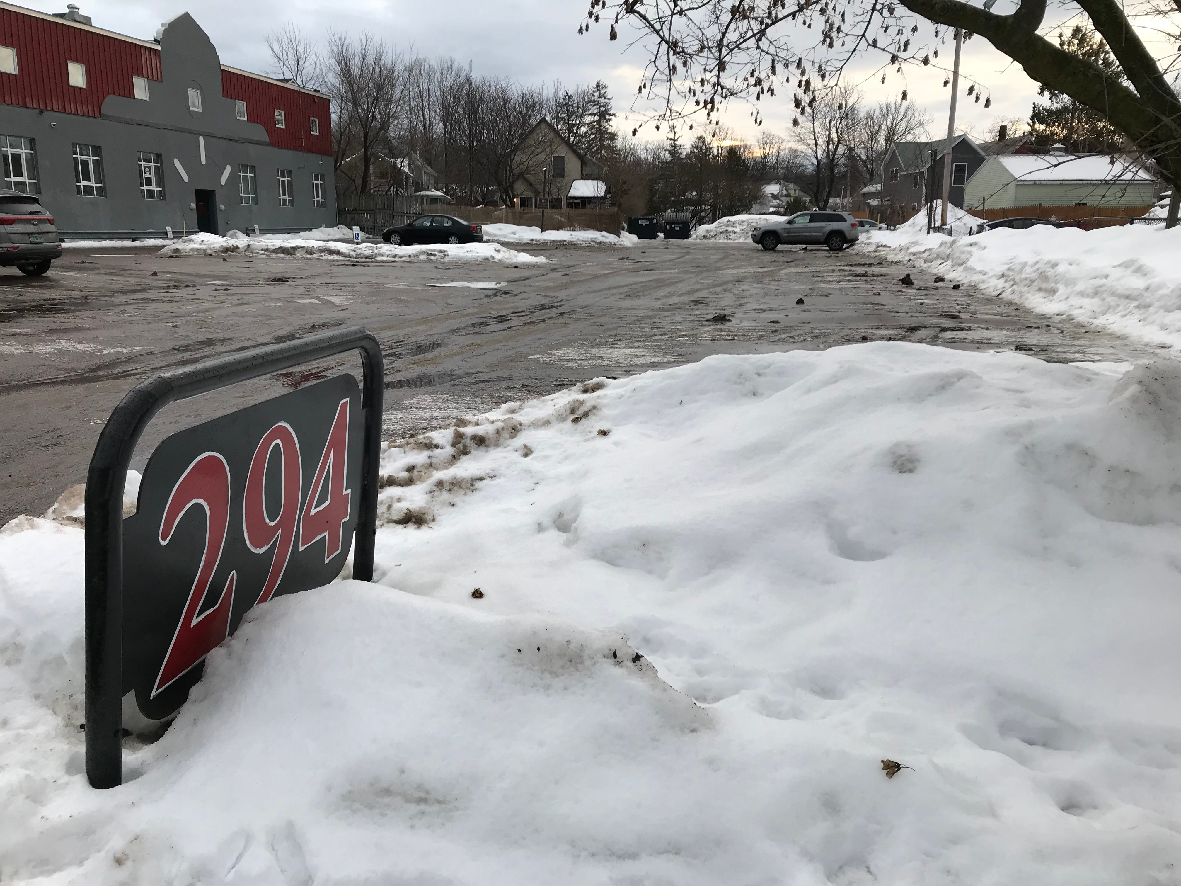 The parking lot entrance to 294 N. Winooski Ave. in Burlington on Monday morning of Feb. 4, 2019. A University of Vermont student was found unconscious at this location on Saturday and was declared dead at the scene. Police say sub-zero temperatures may have been a factor in the death.