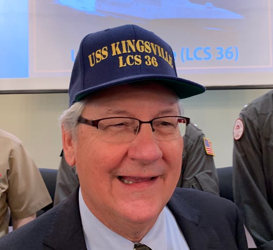 Kingsville Mayor Sam Fugate dons a cap celebrating the US Navy's announcement to name a new vessel after the military town.