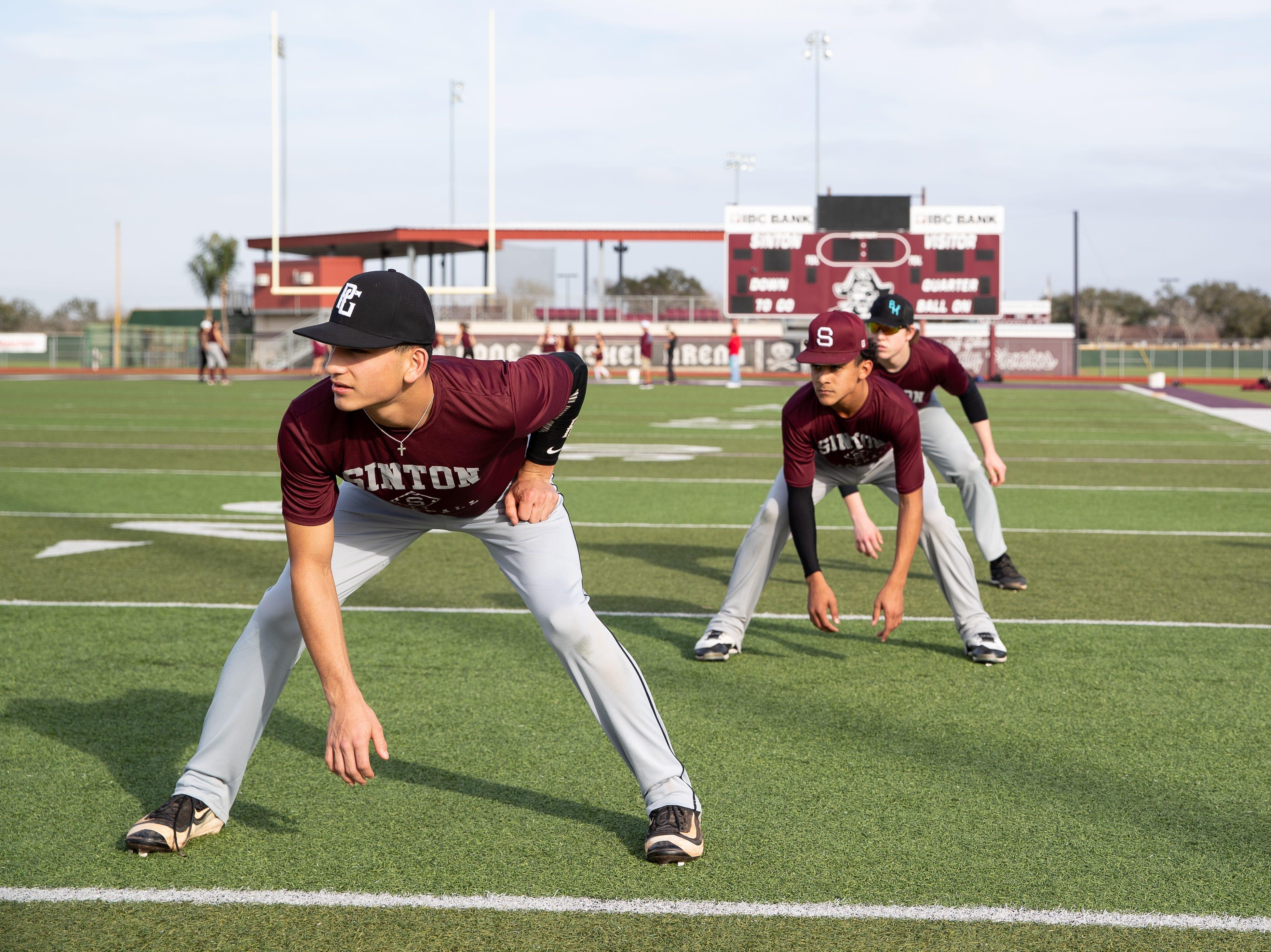 Sinton High School baseball team does base running drills during practice on Friday, Feb. 1, 2019.