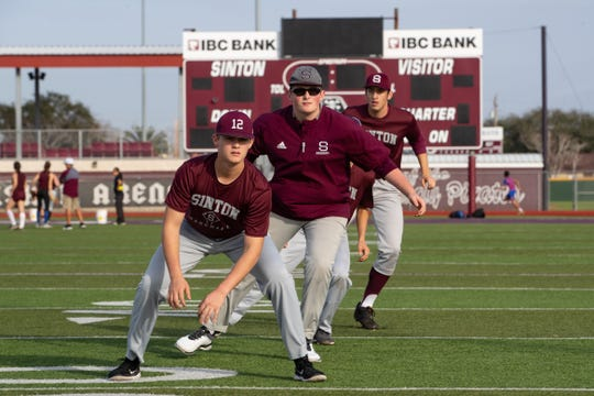Sinton High School baseball team does base running drills during practice on Friday, Feb. 1, 2019.