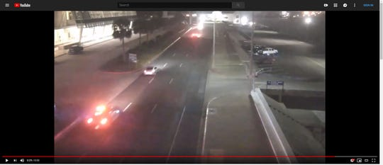 The Corpus Christi Police Department released surveillance footage of two vehicles racing on Shoreline Boulevard, near the American Bank Center.