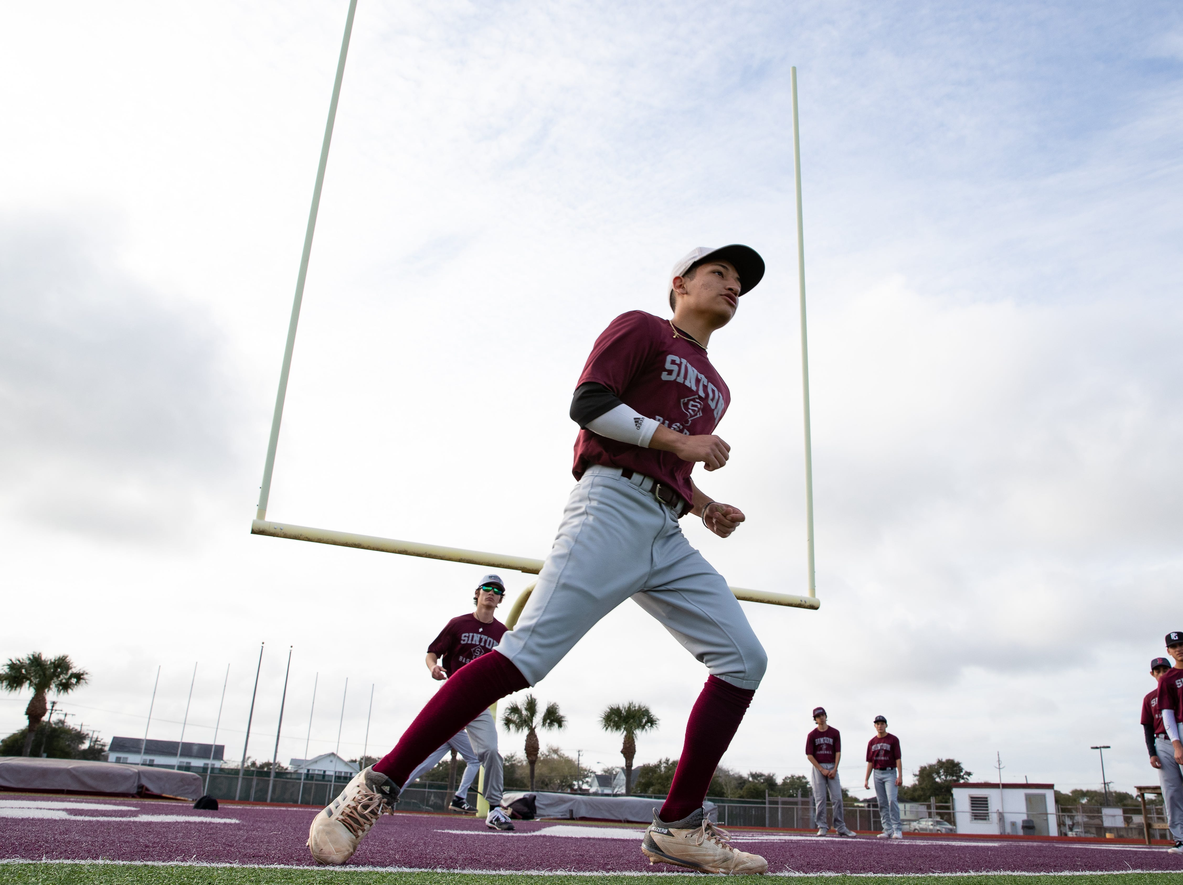 Sinton High School baseball team does base running drills during practice on the football field do to a wet field on Friday, Feb. 1, 2019.