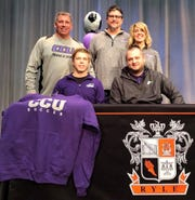 James Spindley signs Feb. 4 at Ryle High School to play soccer for Cincinnati Christian University. Joining James, front left, and Cincinnati Christian head soccer coach Connor Campbell, front right, are father, Jamie Spindley, stepfather, Mike McClurg, and mother, Jami McClurg.