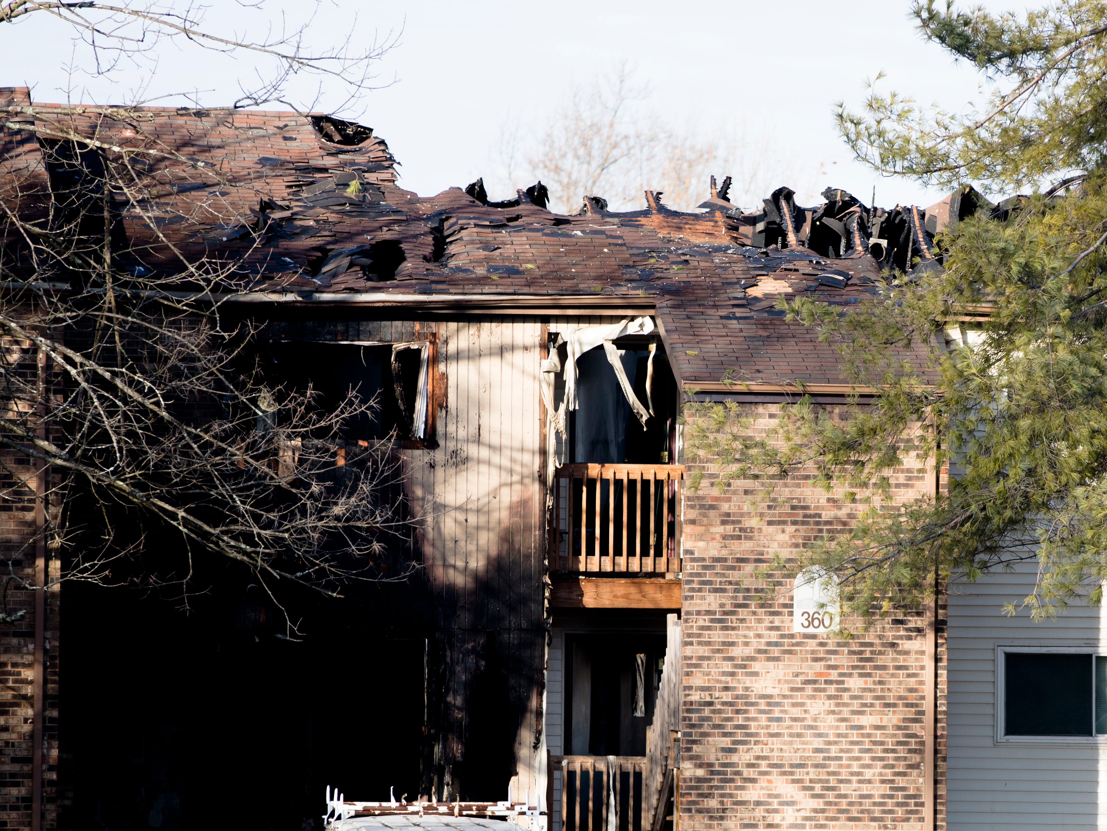 A view of  fire damage on the apartment on Monday, Feb. 4, 2019, in Clermont County after it was damaged in a fire that occurred during a police standoff on Saturday. Detective Bill Brewer was a 20-year veteran of the Sheriff's Office and was injured on the scene by gunfire before the fire was set to the apartment. He died from his wounds at Anderson Mercy Hospital. Wade Edward Winn, 23, was taken into custody by police Feb. 3, 2019, as the suspect in deadly overnight standoff that resulted in Clermont County Sheriff's Office deputy Bill Brewer and the fire that destroyed Buchanan's apartment as well as others.