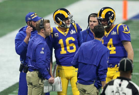Rams head coach Sean McVay talks with quarterback Jared Goff (16) while expected Bengals coach Zac Taylor looks on during the third quarter of Super Bowl LIII.