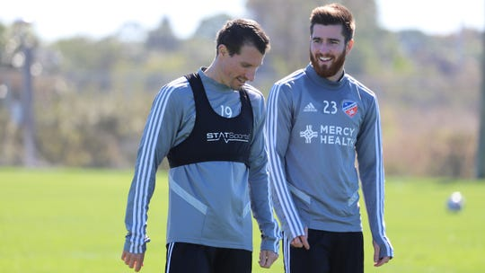 Corben Bone (left) and Blake Smith (right) converse during an FC Cincinnati preseason training session at IMG Academy Jan. 29, 2019.