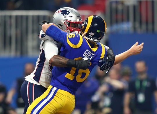 Los Angeles Rams quarterback Jared Goff (16) is hit by New England Patriots outside linebacker Dont'a Hightower (54).
