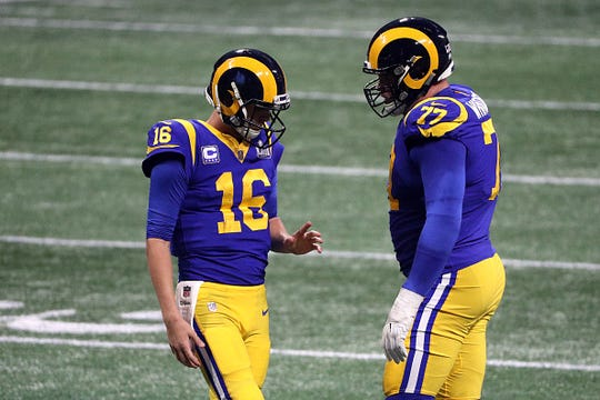 Jared Goff (left) and Andrew Whitworth of the Los Angeles Rams speak in the second half against the New England Patriots during Super Bowl LIII at Mercedes-Benz Stadium on February 03, 2019 in Atlanta, Georgia.