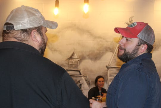 Kings Bluff Brewery co-owner Dustyn Brewer chats with a customer on their opening weekend.