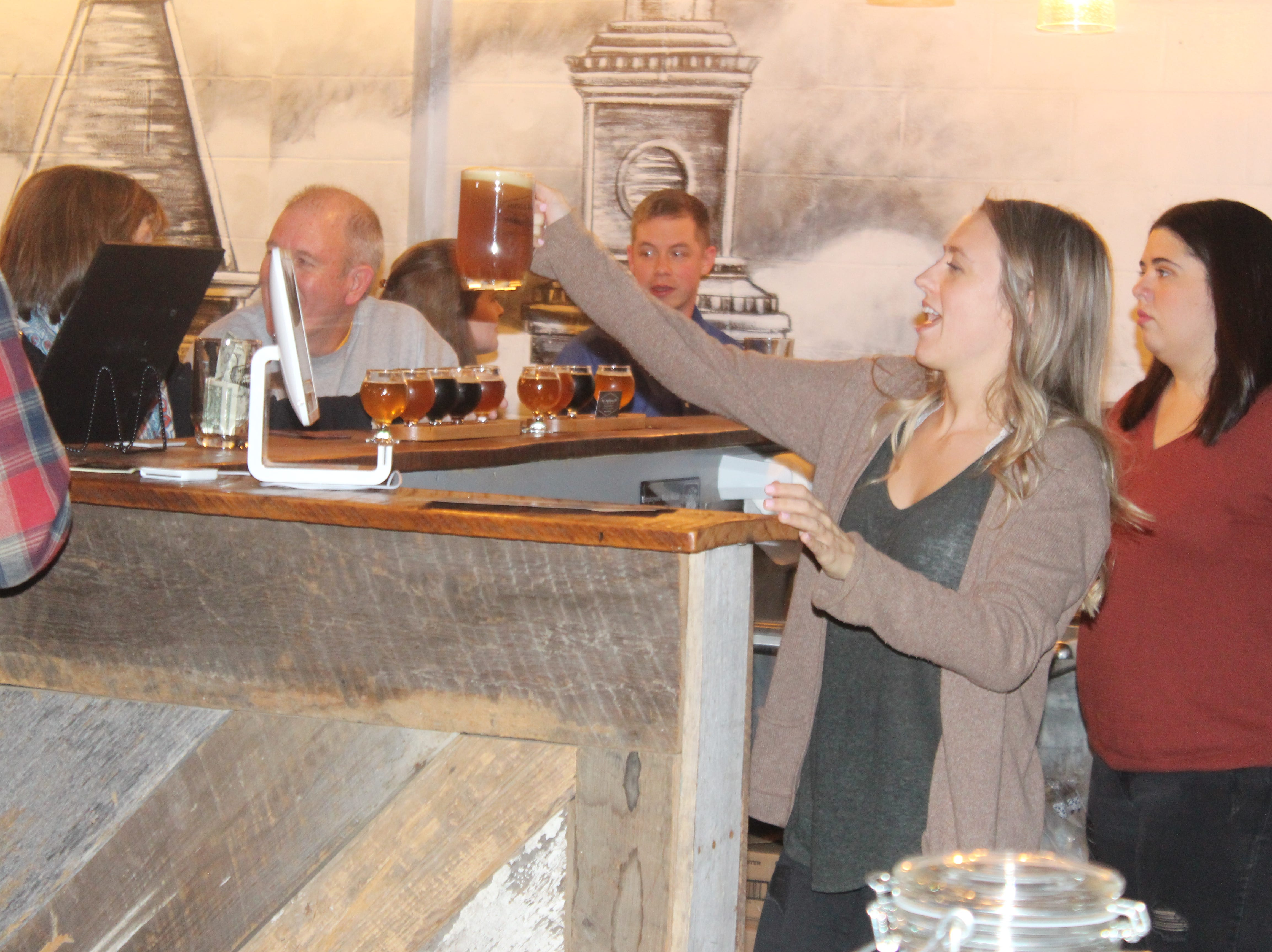 Serving up a cold brew at Kings Bluff Brewery in downtown Clarksville, which just opened.