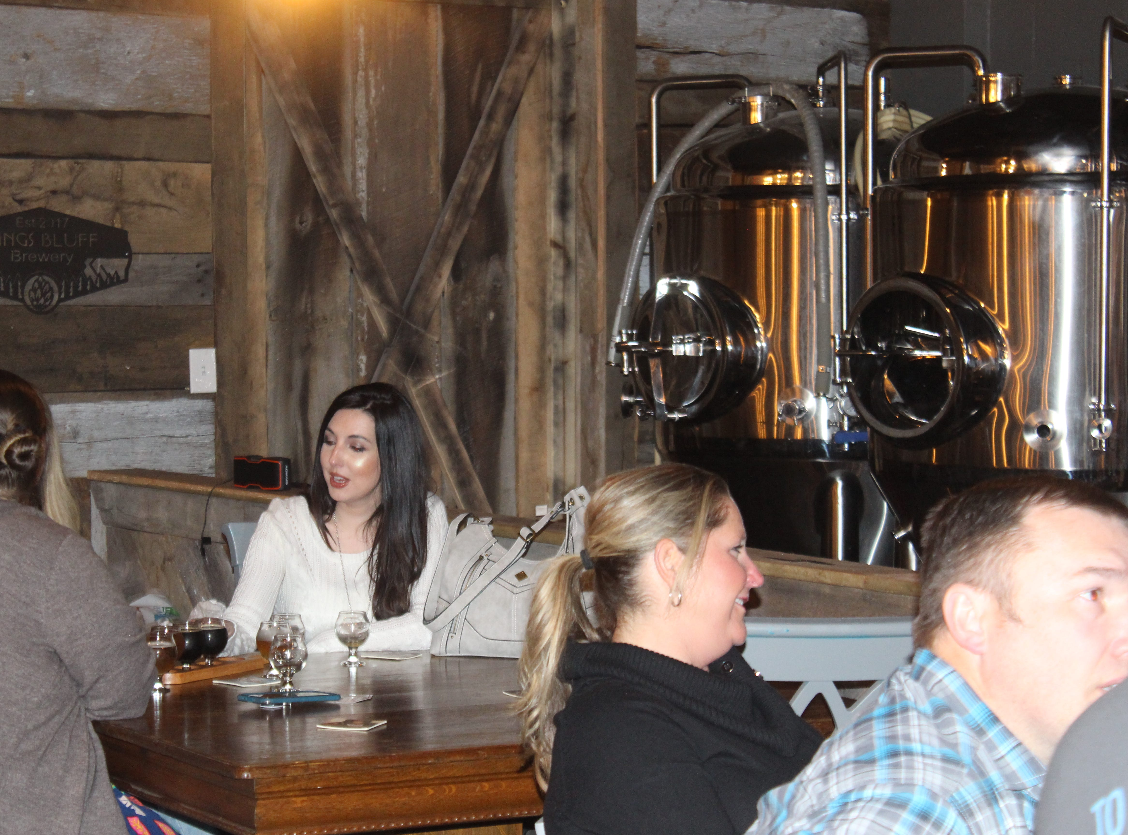 Customers get a sample of what's on tap at the new Kings Bluff Brewery in downtown Clarksville