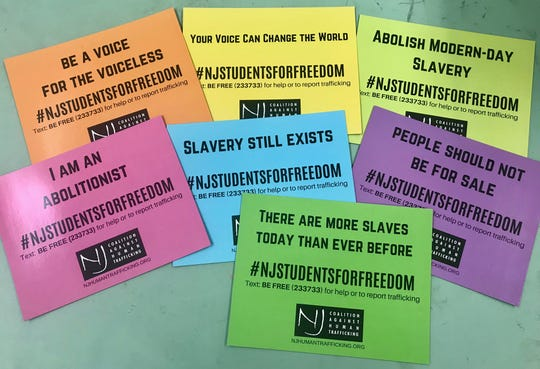 Seven different magnets from the New Jersey Coalition Against Human Trafficking.