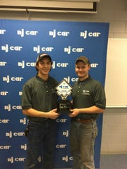 Hunterdon County Polytech students Austin Tarby and Patrick Willey (left to right) celebrate their first-place finish at the recent New Jersey Auto Tech Competition.