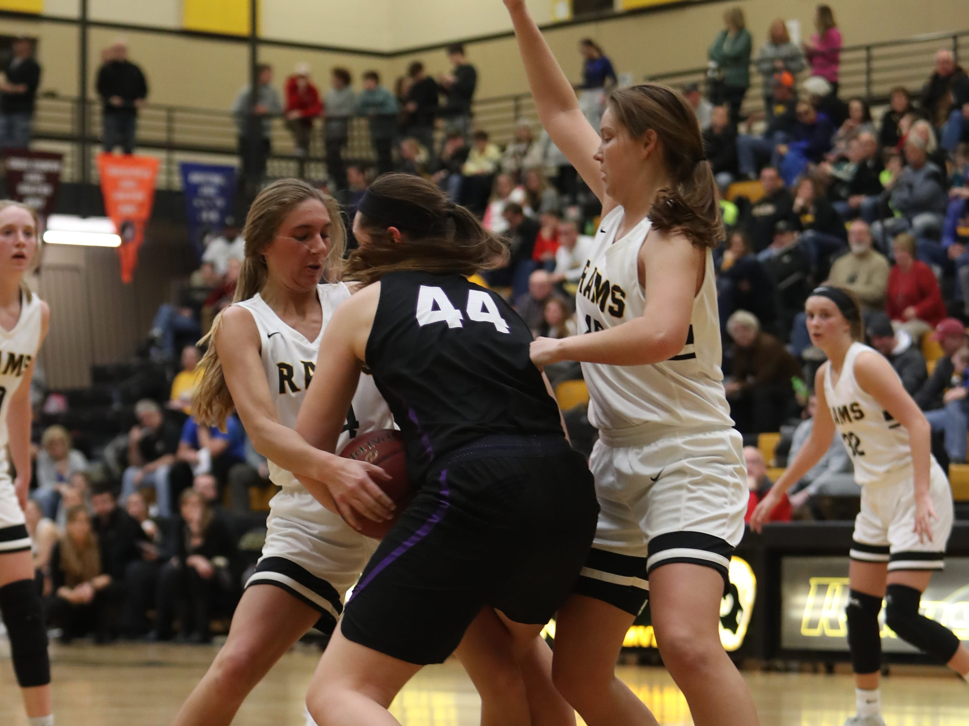 Waukee Warriors' Paityn Rau (44) and Southeast Polk Rams' Jessica Stuart (14) battle for a loose ball during a game Feb. 1, 2019 at Southeast Polk High School. The Warriors beat the Rams 66 to 43.
