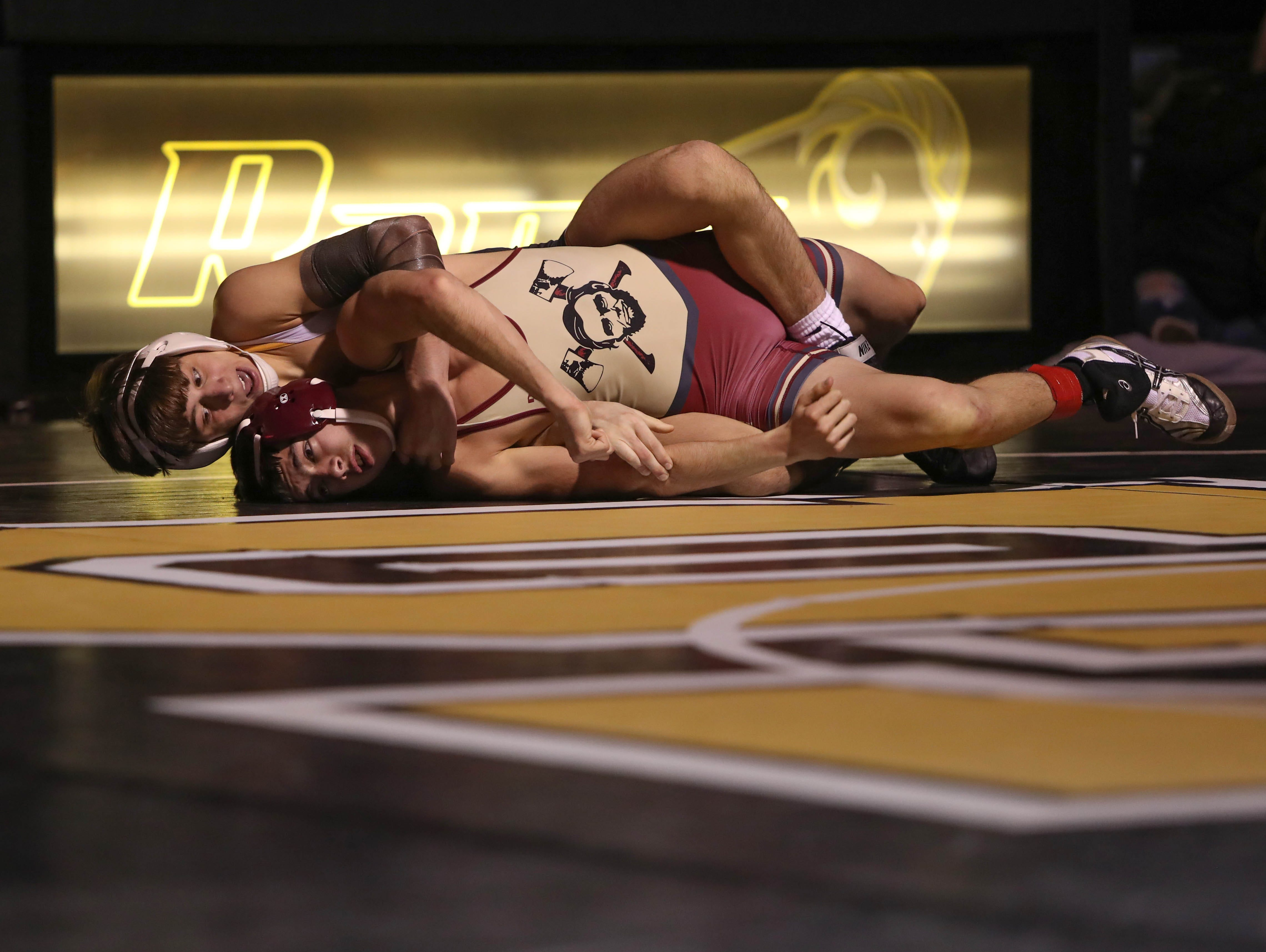 Southeast Polk's Joel Jesuroga wrestles with Des Moines Lincoln's Nate Bell. The Rams won 61-12 against Lincoln in the Jan. 31, 2019 match at Southeast Polk High.