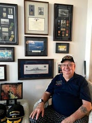 World War II veteran and Cedar Rapids-native Barney Hanson with a collection of military memorabilia.