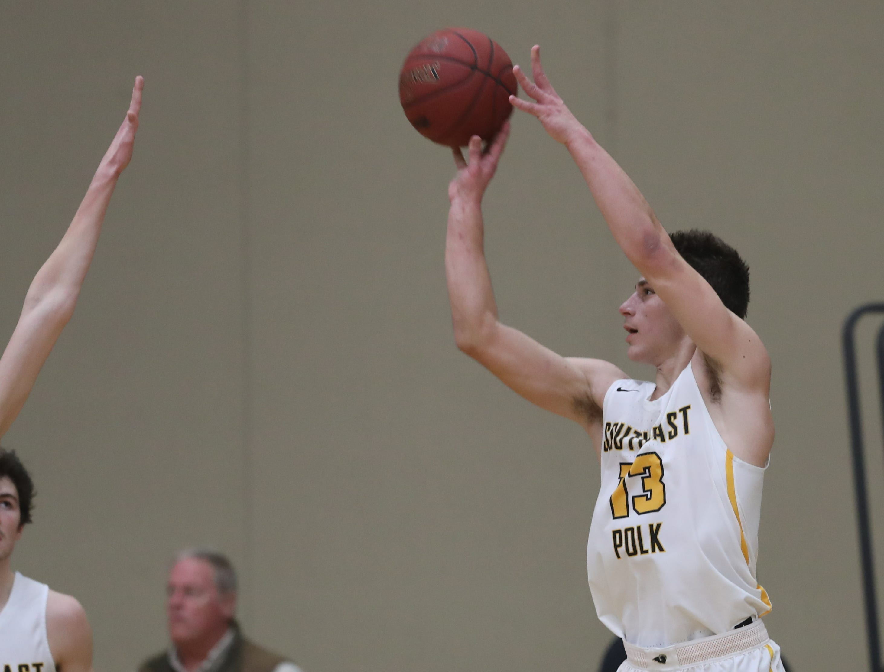 Southeast Polk Rams' Dominic Caggiano (13) shoots against the Waukee Warriors during a game on Feb. 1, 2019 at Southeast Polk High School.